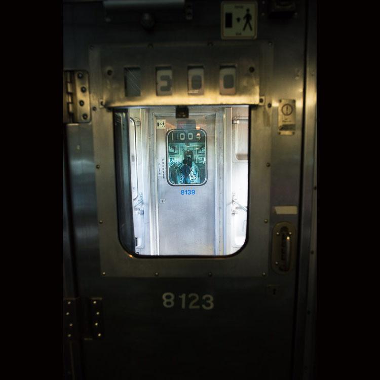 Child in aisle through train window