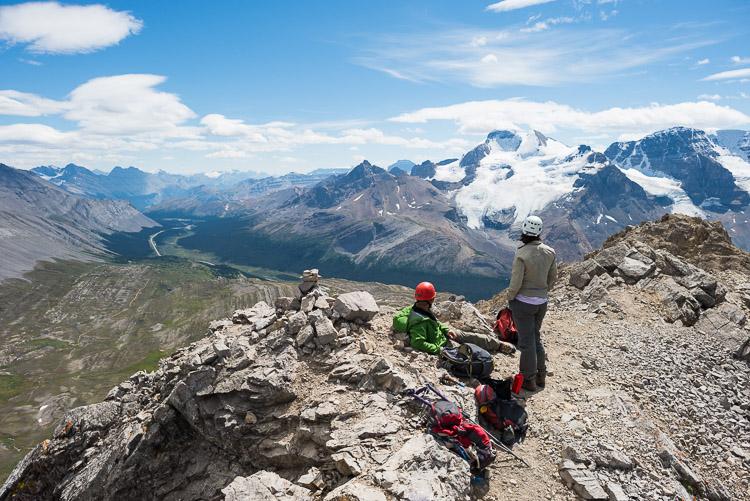 Climbing couple sits atop Mount Wilcox's peak