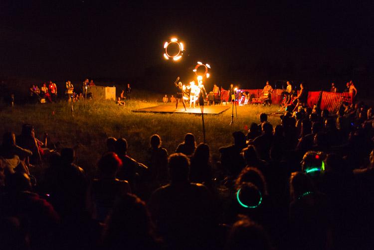 Mesmerized by fire dancers at Pope's Hill - Winnipeg Folk Festival