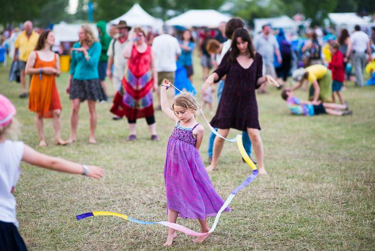 Child dances at Winnipeg Folk Festival