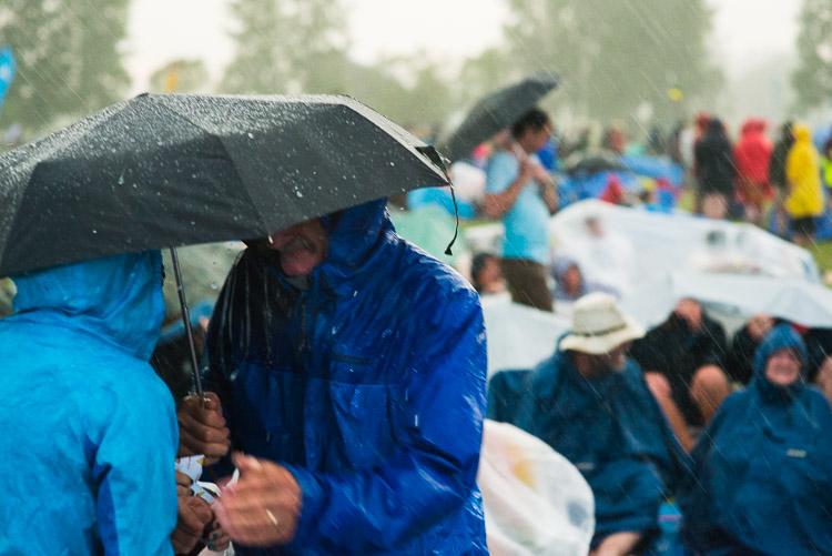 Older couple takes shelter from the Winnipeg Folk Festival 2015 huge Sunday storm