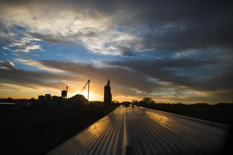 Prairie grain elevator at sunset - as see from VIA Rail train