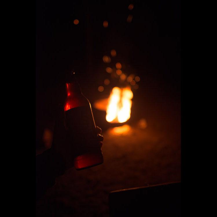 Drinking beer at campfire
