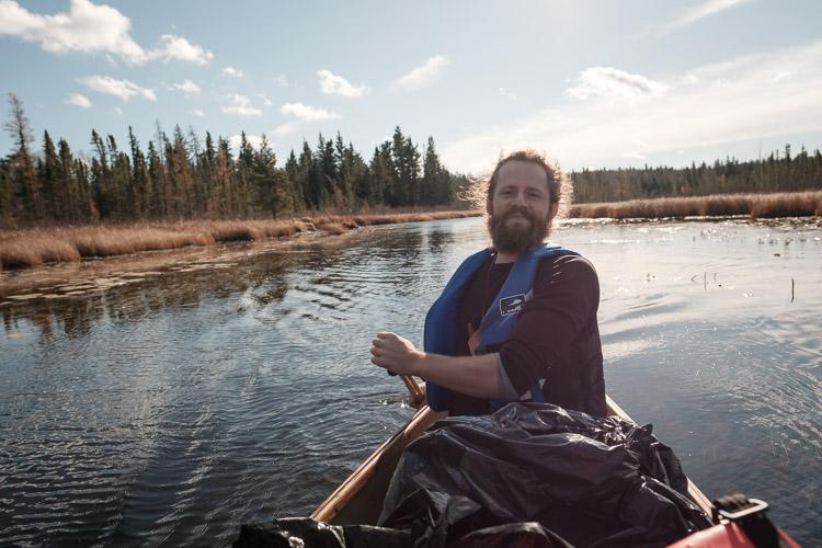 Canoe paddler in late October sunshine