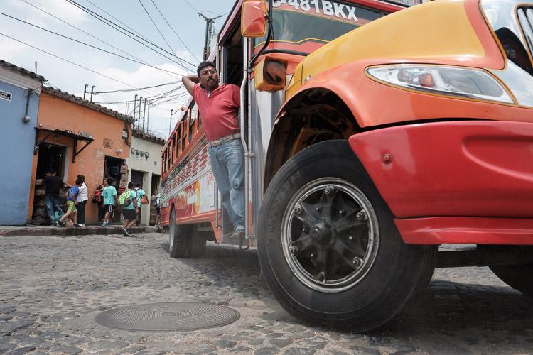 Chicken bus on cobblestone streets of Antigua, Guatemala