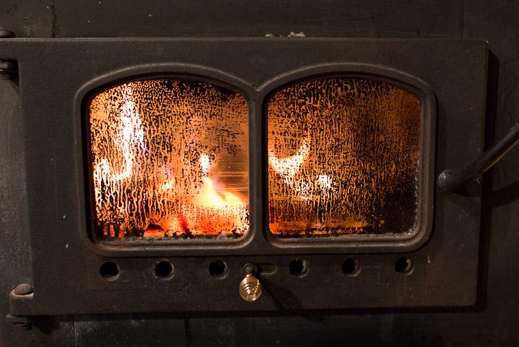 Stoked wood stove.