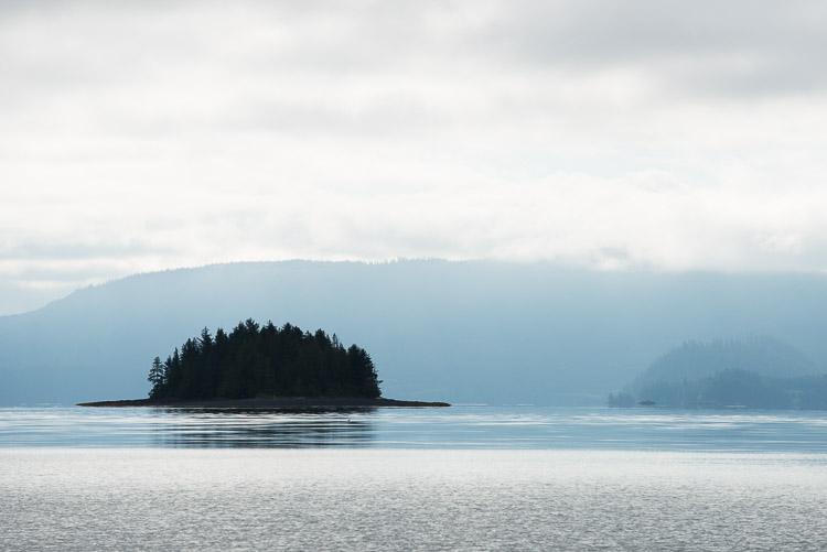 Quintessential Haida Gwaii island silhouetted against fog