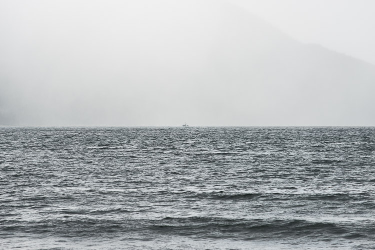 Distant sailboat in rainy Rennell Sound