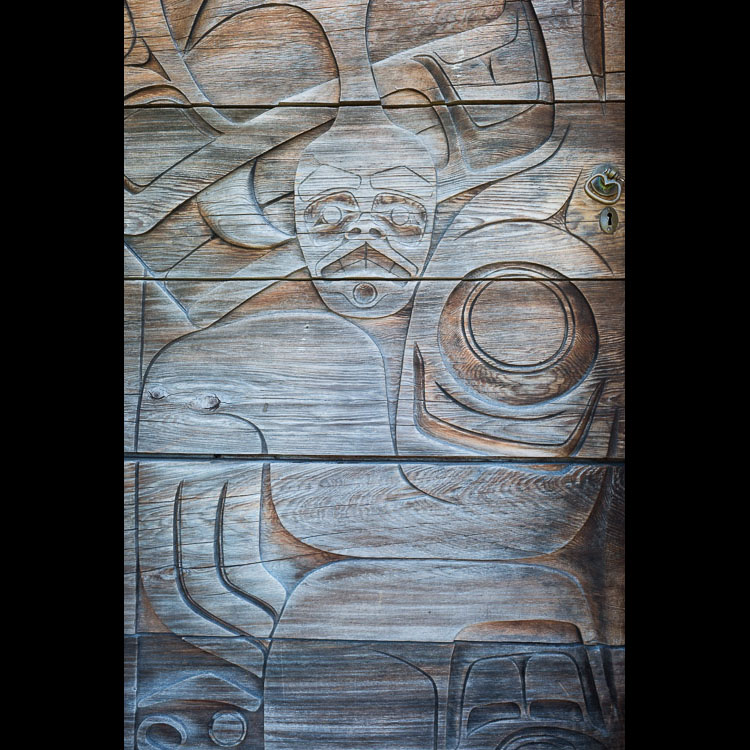 Beautiful Haida art on a carved doorway in Old Masset