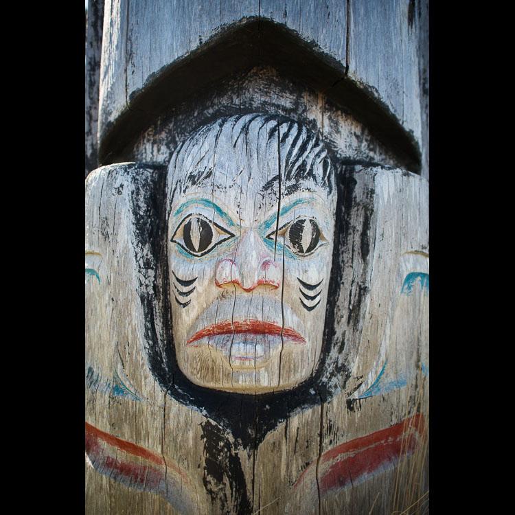 Weathered face on a Haida totem pole