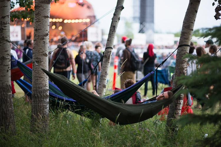 Relaxing in a hammock while listening to main stage music