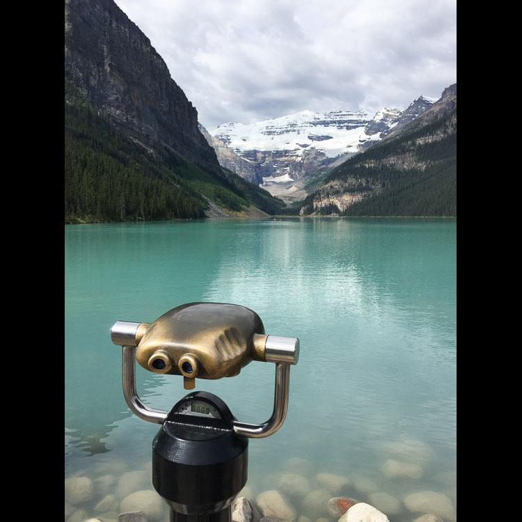 Lake Louise binoculars at lake edge