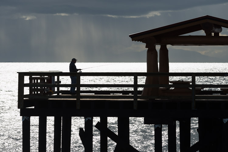 Fisherman silhouette on pier near Sechelt - Sunshine Coast