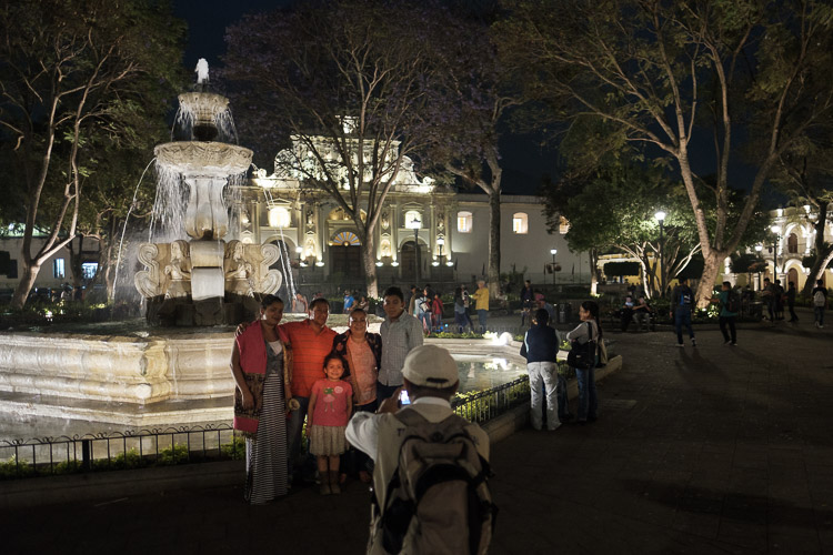Local tourists in Central Park at night - Antigua, Guatemala