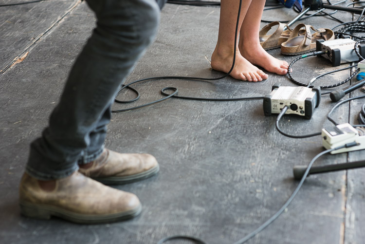 Barefoot musician on stage