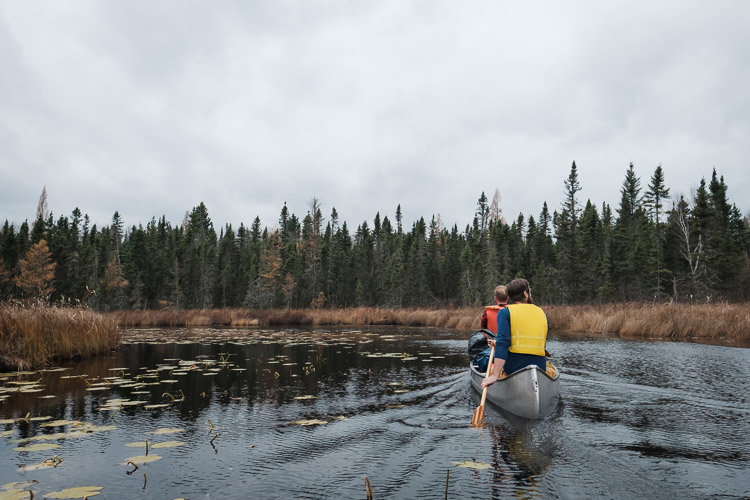 Paddling canoe in a calm river